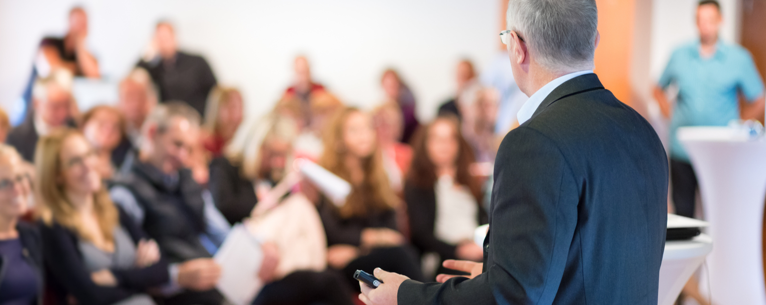 Speaker at Business Conference with Public Presentations