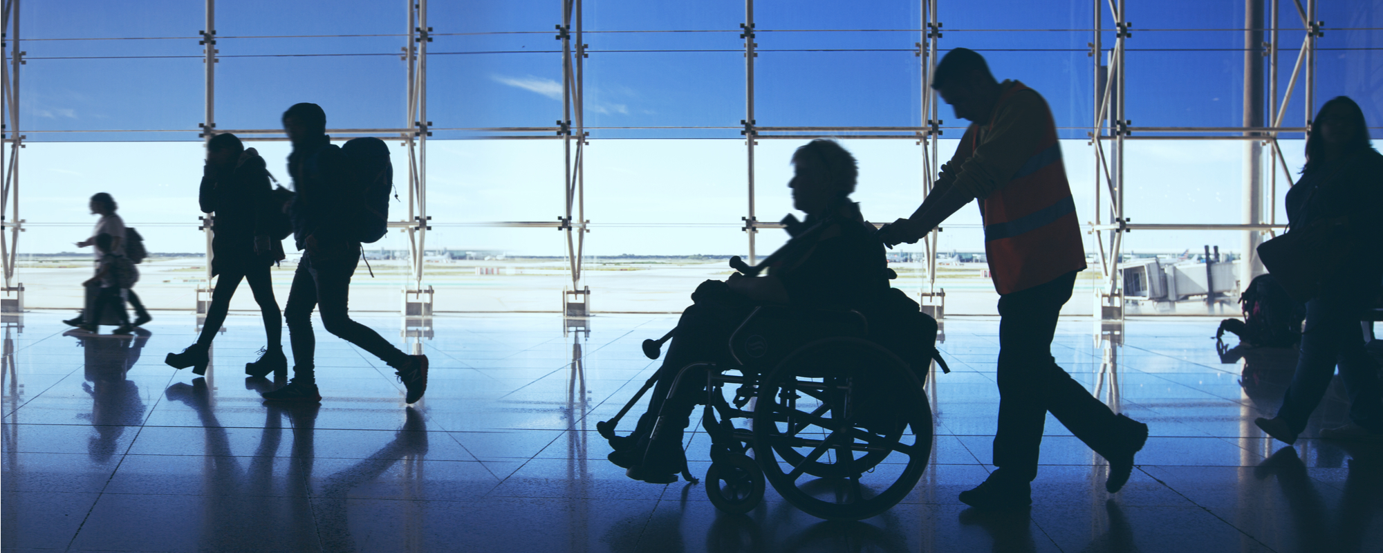 Airport Employee helping a guest on a wheelchair