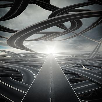Big sunlit straight road on winding roads