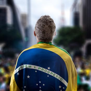 Brazilian-holding-the-flag-of-Brazil-in-Paulista-Avenue