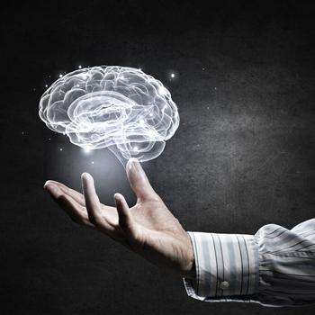 Close-up-of-human-hand-holding-brain-symbol