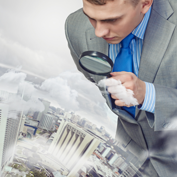 Image-of-businessman-examining-objects-with-magnifier