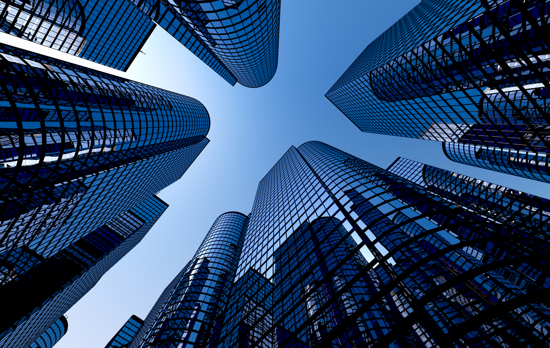 Low angle shot of modern glass city buildings with clear sky background
