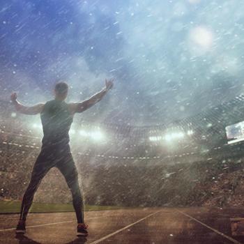 Portrait-of-man-posing-in-stadium-during-epic-rain