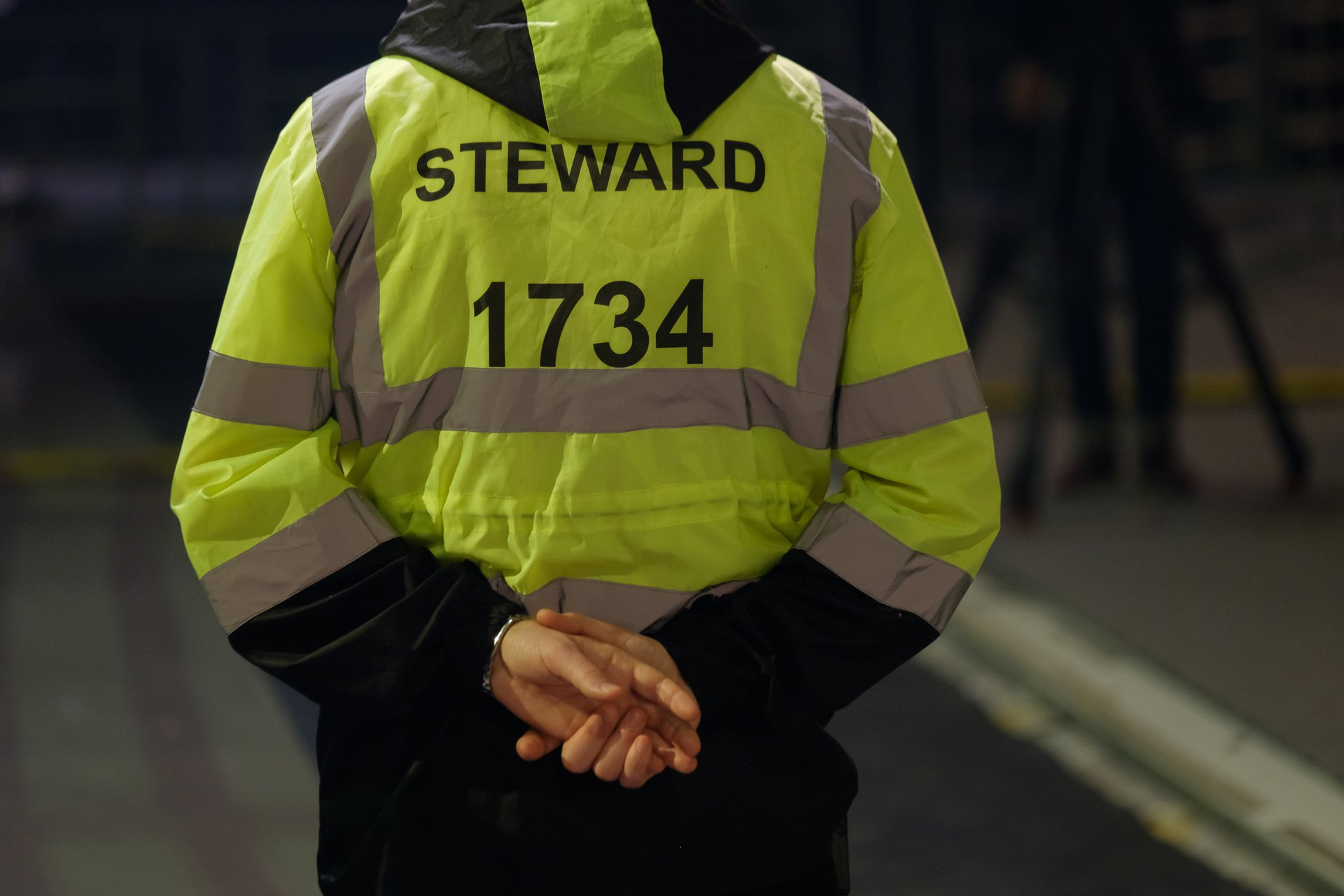 Steward works at an event, back view
