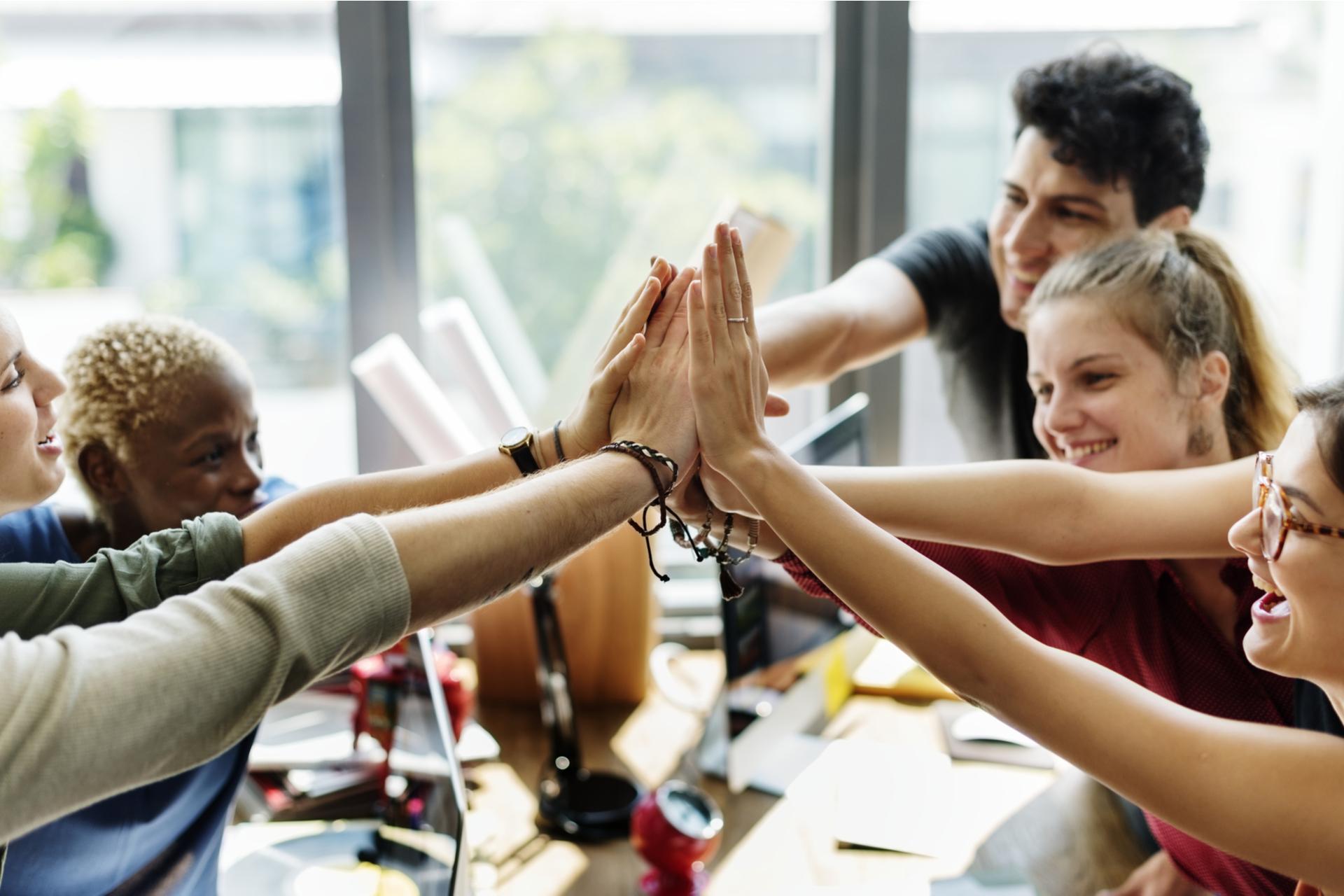 Teamwork successful high five together