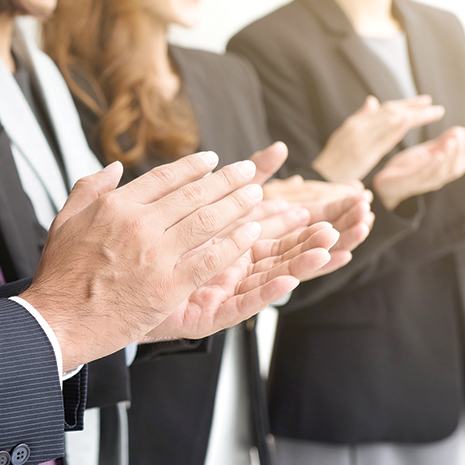 Business people clapping their hands in appreciation.png