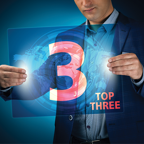 Businessman holding a transparent screen with an inscription of top three