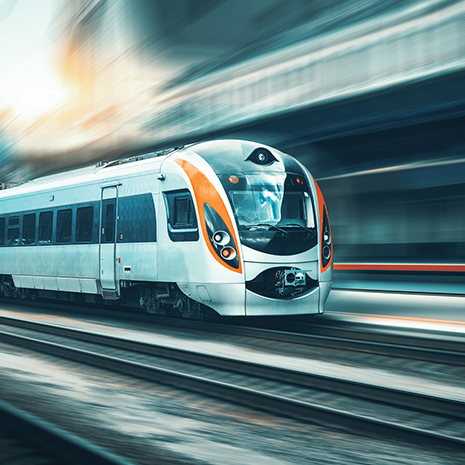 High speed train in motion at the railway station at sunset.png
