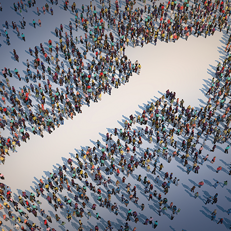 Large group of people forming a arrow symbol