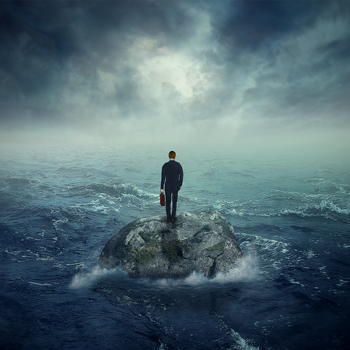 Lonely-young-man-on-a-rock-cliff-island-surrounded-by-storm-waves.png