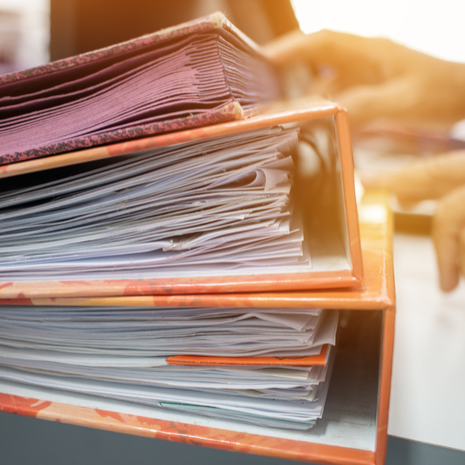 Many Stacks of document folders in office