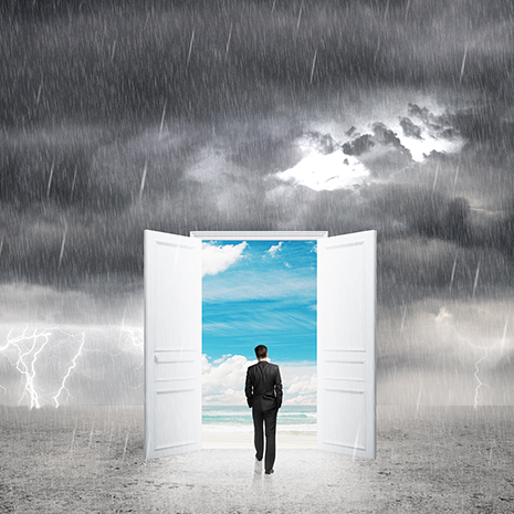 businessman walking to opened door from bad weather to good