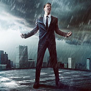 businessman yelling victory in the pouring rain in front of buildings.png