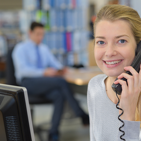 businesswoman on the phone in her office using IMS