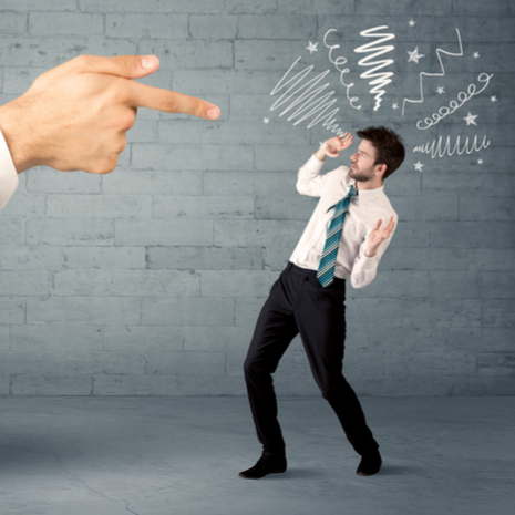 huge hand pointing at business person