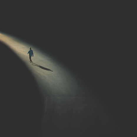 man walking in the night