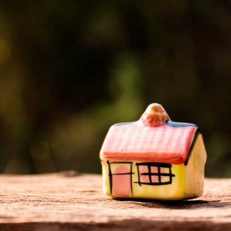 miniature house on wooden blurred background