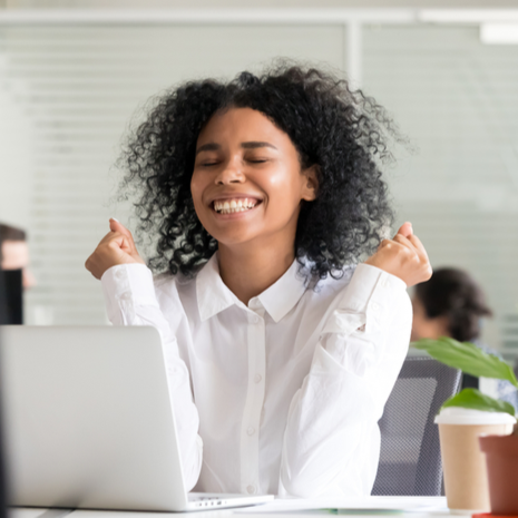 motivated happy black female employee celebrating great result achievement