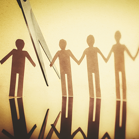 paper cut out chain of people being cut showing broken communication concept.png