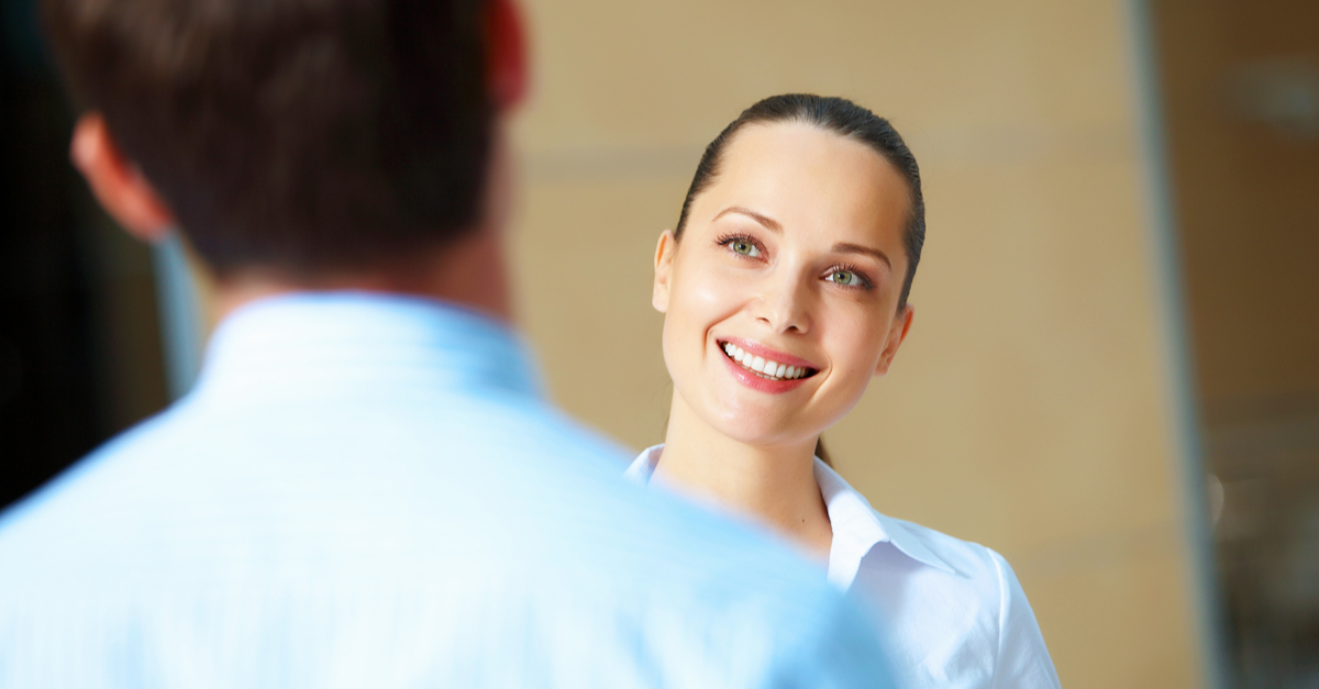 woman communicating and smiling with man
