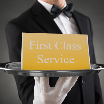 customer-service-sign-sitting-on-silver-platter-held-by-white-glove-service