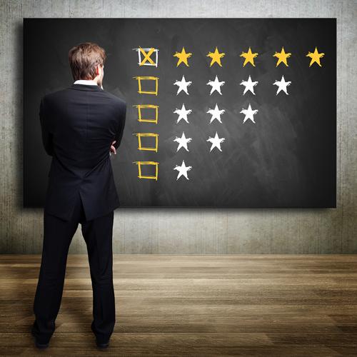 facility-manager-looking-at-cmms-software-reviews