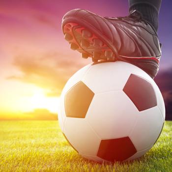 foot-of-robert-lewandowski-on-soccer-ball-with-sunset-backdrop