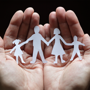 hands-that-use-incident-reporting-software-protecting-a-paper-cut-out-of-a-family