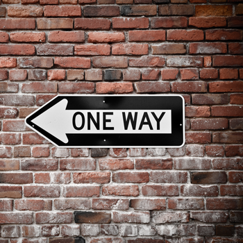 one-way-text-communication-sign-on-brick-wall