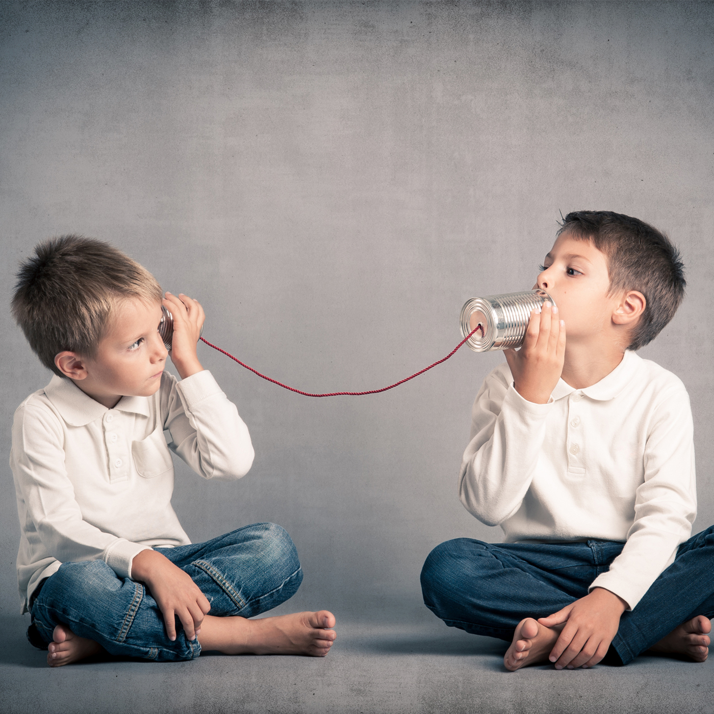 two-brothers-communicating-with-homemade-string-and-can-telephone